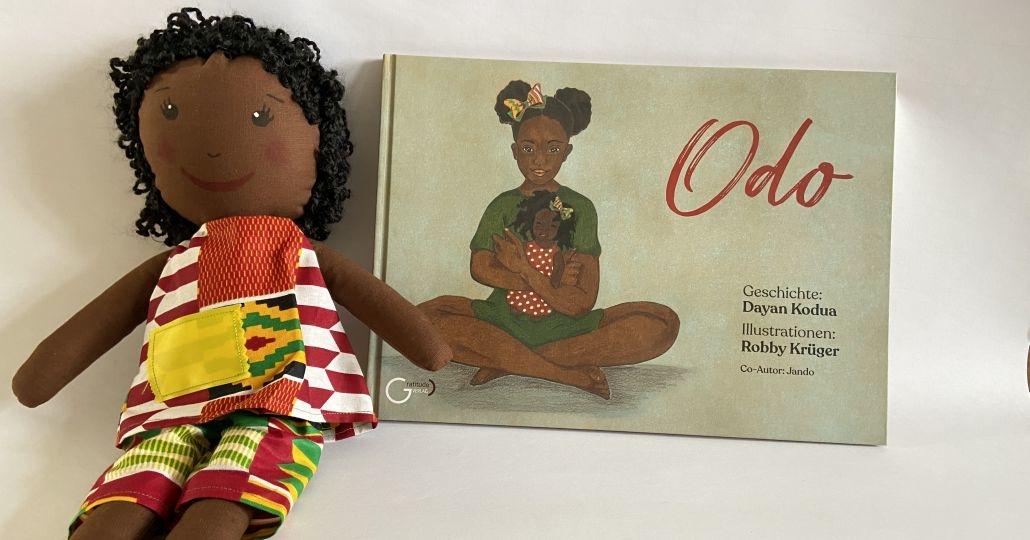 Odo Buch und Puppe